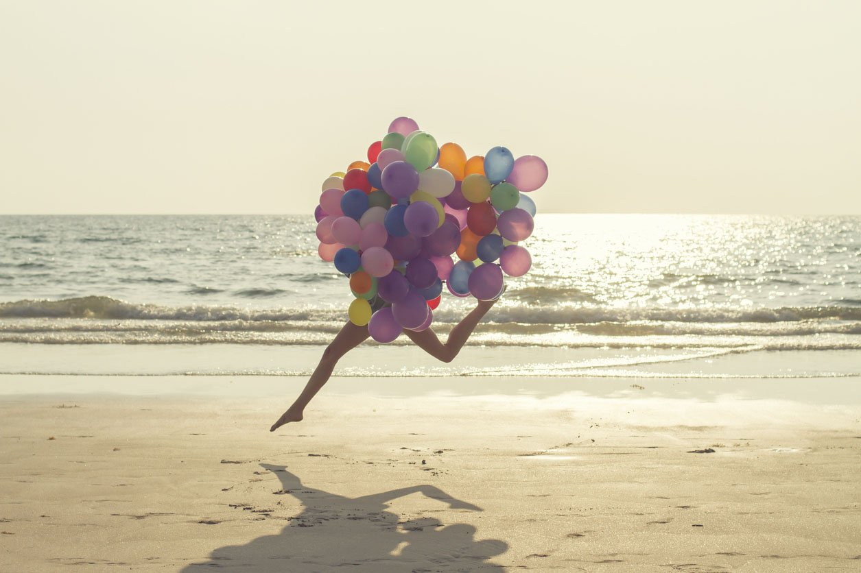 jumping girl with balloons